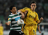 20120329: LISBON, PORTUGAL - Football - UEFA Europe League 2011/2012 - Quarter-finals, First leg: Sporting CP vs Metalist<br />In picture: Sporting's Matias Fernandez, from Chile, left, fights for the ball with Metalist's Milan Obradovic, from Serbia.<br />PHOTO: Alvaro Isidoro/CITYFILES