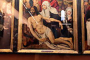 old religious painting display protected by glass