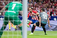 Atletico de Madrid's Juanfran Torres and Malaga's Federico Ricca and Roberto Jimenez during La Liga match between Atletico de Madrid and Malaga CF at Wanda Metropolitano in Madrid, Spain September 16, 2017. (ALTERPHOTOS/Borja B.Hojas)