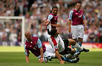 Photo: Frances Leader.<br />Fulham v West Ham. The Barlcays Premiership.<br />17/09/2005.<br />West Ham's Paul Konchesky tackles Fulham's Steed Malbranque.