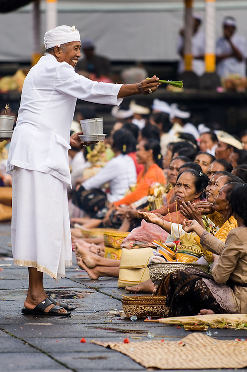 Portrait of a Hindu priest blessing the devotees during a Nyepi celebration at Besakih Temple in Bali