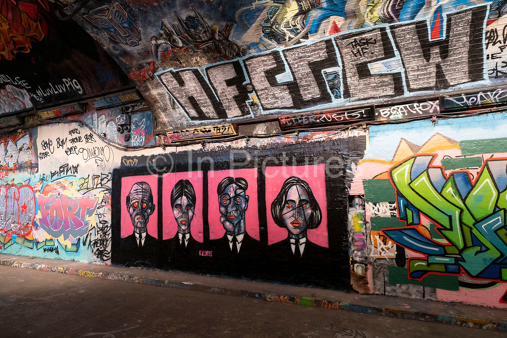 Spray painted street art and graffiti at the popular Leake Street Arches on 13th April 2021 in London, England, United Kingdom. Leake Street is a road tunnel in Lambeth, where graffiti is tolerated and encouraged regardless of the fact that it is against the law. The street is about 300 metres long, runs off York Road and under the platforms and tracks of Waterloo station.