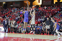 NORMAL, IL - November 06: Isaac Gassman shoots a long 3 over Troy Baxter Jr during a college basketball game between the ISU Redbirds  and the Florida Gulf Coast Eagles on November 06 2018 at Redbird Arena in Normal, IL. (Photo by Alan Look)