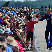 BRUNSWICK Maine- 8/26/17 --  U.S. Navy Lt. Brandon Hempler, Blue Angels Narrator, greets a fan on Saturday during the demonstration team's show at Brunswick Executive Airport.  The Blue Angels flew as part of the Great State of Maine Airshow this weekend. Officials estimated that over 100,000 people enjoyed the show from inside and outside the gates. There were more static displays than there were in 2015's show and officials concluded not was a larger draw than in previous years.  Photo by Roger S. Duncan for The Forecaster.