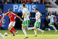 Gareth Bale of Wales (l) breaks away from his markers. UEFA Euro 2016, last 16 , Wales v Northern Ireland at the Parc des Princes in Paris, France on Saturday 25th June 2016, pic by  Andrew Orchard, Andrew Orchard sports photography.