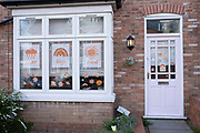 Local response to Coronavirus is felt on a street by street level as children put up rainbow paintings in the windows of their homes on 6th April 2020 in Birmingham, England, United Kingdom. Rainbows, mostly drawn by children, have been appearing in windows right across the UK as people are locked in their homes during the coronavirus outbreak, and want to give out a positive message, in particular to NHS staff and other key workers. Coronavirus or Covid-19 is a new respiratory illness that has not previously been seen in humans. While much or Europe has been placed into lockdown, the UK government has announced more stringent rules as part of their long term strategy, and in particular social distancing.