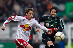 13.02.2011, Tivoli Stadion, Innsbruck, AUT, 1. FBL, FC Wacker Innsbruck vs Red Bull Salzburg, im Bild Christoph Leitgeb, (FC Red Bull Salzburg, Mittelfeld, #24) Carlos Merino Gonzalez, (FC Wacker Innsbruck, Mittelfeld, #11) // during the Austrian Bundesliga Match, FC Wacker Innsbruck vs Red Bull Salzburg at Tivoli Stadium, Innsbruck, EXPA Pictures © 2011, PhotoCredit: EXPA/ J. Feichter