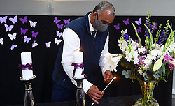 SOUTH AFRICA - Cape Town - 15 October 2020- Keith Griffiths who lost his wife who was a Palliative patient,lights a candle in commemoration of the lives lost to Covid-19 on World Palliative Care Day.The event which was hosted at the Lentergeur Psychiatric hospital in Mitchell's Plain was also attended by Minister of Health in the Western Cape NomaFrench Mbombo .Photograph; Phando Jikelo/African News Agency(ANA)