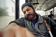 Mario in a bus during a trip to the Roma settlement in Jarovnice, Slovakia. Mario is a well known blind Roma musician originally from Slovakia living since he finished his studies in Prague, Czech Republic. Beside being a very talented multi-instrumentalist working as a professional musician he is also experimenting with photography as a another way to express himself.