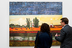 "© Licensed to London News Pictures. 30/09/2016. London, UK.  ""Grasshopper"" by Peter Doig (est. GBP2.8-3.4 million) is viewed by a staff member and his client at the preview of Sotheby's London upcoming Contemporary Art Auctions.  Photo credit : Stephen Chung/LNP"