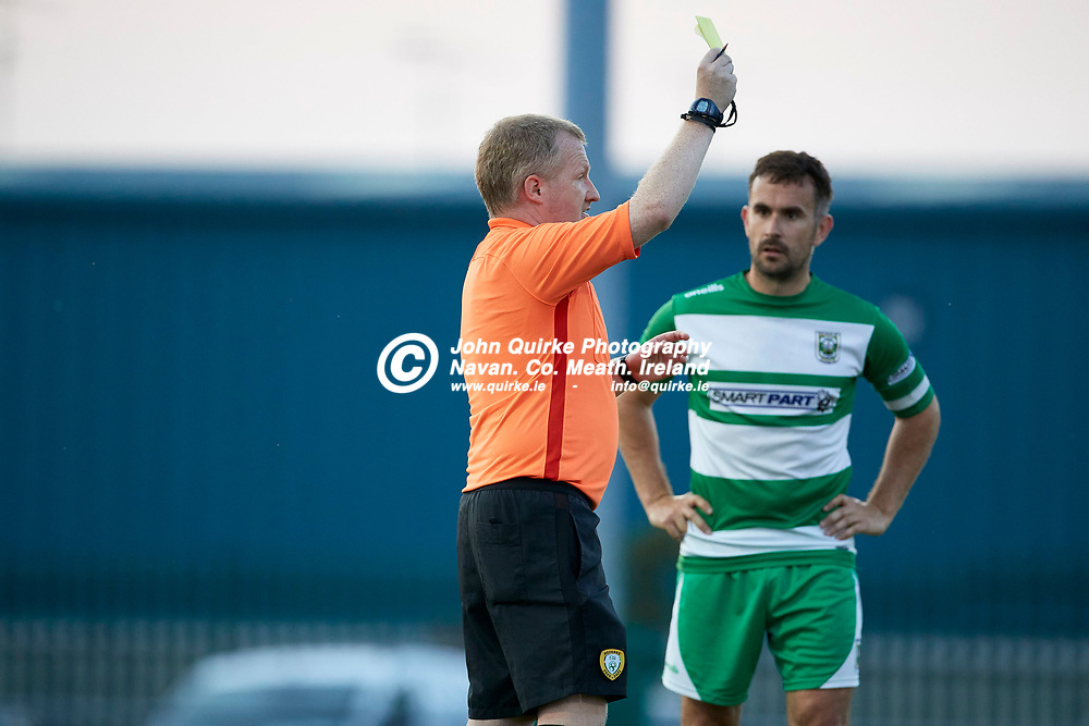 23-07-21, Premier Soccer at Claremont Stadium<br /> Parkvilla v Trim Celtic<br /> Trim Celtic`s James Goggins receives a yellow card from referee S.McMahon<br /> Photo: David Mullen / www.quirke.ie ©John Quirke Photography, Proudstown Road Navan. Co. Meath. 046-9079044 / 087-2579454.<br /> ISO: 2000; Shutter: 1/1250; Aperture: 4.5;
