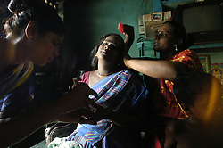 """G. Velvish,27, right, brush hair of her transgender sisters at her hut in Chennai, India. <br /> As transgenders,""""hijras"""" in local terms, are acutely marginalized in Indian society, the major earning avenues for them are sex work, begging and performing at rituals."""