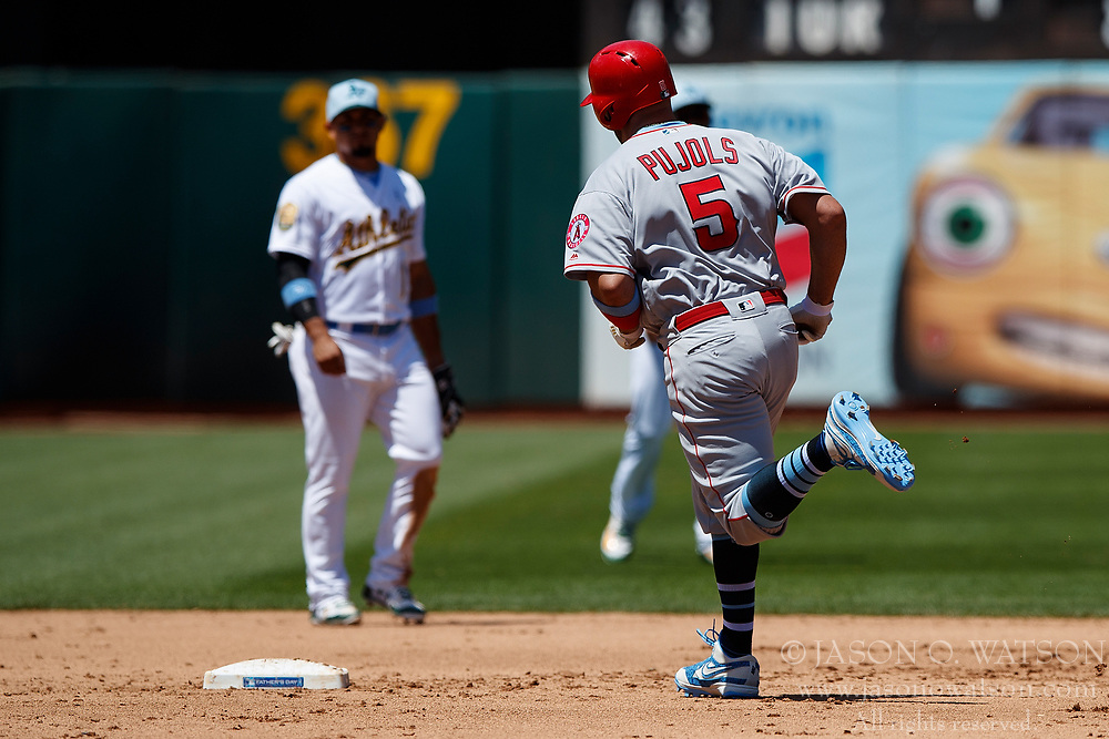 OAKLAND, CA - JUNE 17: Albert Pujols #5 of the Los Angeles Angels of Anaheim rounds the bases after hitting a home run against the Oakland Athletics during the sixth inning at the Oakland Coliseum on June 17, 2018 in Oakland, California. The Oakland Athletics defeated the Los Angeles Angels of Anaheim 6-5 in 11 innings. (Photo by Jason O. Watson/Getty Images) *** Local Caption *** Albert Pujols