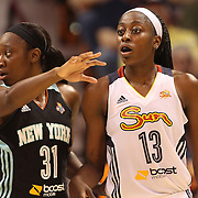 Chiney Ogwumike, (right), Connecticut Sun, the WNBA number one draft pick making her WNBA debut, defended by Tina Charles, New York Liberty and former Sun player during the Connecticut Sun Vs New York Liberty WNBA regular season game at Mohegan Sun Arena, Uncasville, Connecticut, USA. 16th May 2014. Photo Tim Clayton