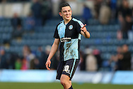 Goalscorer Luke O'Nien of Wycombe Wanderers celebrates after the final whistle towards the home fans. Skybet football league two match, Wycombe Wanderers  v Stevenage Town at Adams Park  in High Wycombe, Buckinghamshire on Saturday 12th March 2016.<br /> pic by John Patrick Fletcher, Andrew Orchard sports photography.