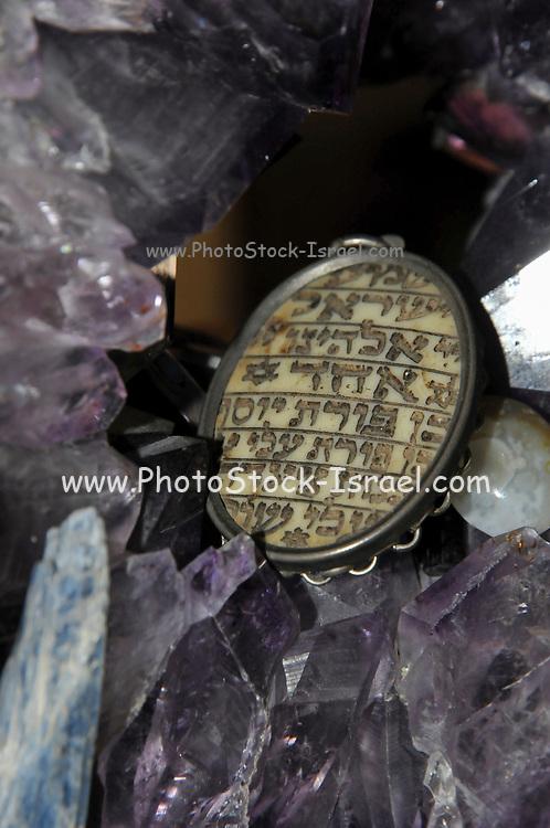 "Studio shot of a decorated Jewish Amulet Shema Yisrael (Sh'ma Yisrael ""Hear, Israel"")"
