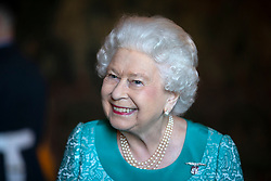 Queen Elizabeth II attends a reception for 603 (City of Edinburgh) Squadron, Royal Auxiliary Air Force, who have been honoured with the Freedom of The City of Edinburgh, at the Palace of Holyroodhouse in Edinburgh.