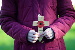 Children from schools across Swindon carry crosses in the Royal Wootton Bassett Field of Remembrance at Lydiard park, Swindon, as it opens to honour and remember those who have been lost serving in the Armed Forces.