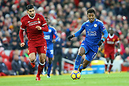 Demarai Gray of Leicester City (r) gets away from Emre Can of Liverpool. Premier League match, Liverpool v Leicester City at the Anfield stadium in Liverpool, Merseyside on Saturday 30th December 2017.<br /> pic by Chris Stading, Andrew Orchard sports photography.