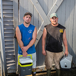Sternman Jackson Feener (lef) and Captain Erick Harjula. of the lobster boat,  'Redeemed' at the Spruce Head Fisherman's Co-op in South Thomaston, Maine.