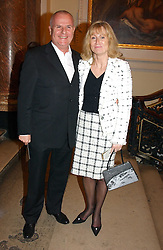 PAUL & ALISON MYNERS he is chairman of Marks & Spencer at a reception to celebrate the opening of Turks:A Journey of a Thousand Years, 600-1600 - an exhibition of Turkish art held at the Royal Academy of Arts, Piccadilly, London on 18th February 2005.<br />