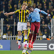 Fenerbahce's Dirk Kuyt (L) and Trabzonspor's Kevin Constant (R) during their Turkish superleague soccer derby Fenerbahce between Trabzonspor at the Sukru Saracaoglu stadium in Istanbul Turkey on Saturday 07 February 2015. Photo by Aykut AKICI/TURKPIX