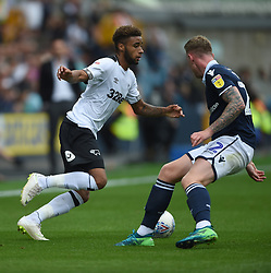 Millwall's Conor McLaughlin and Derby County's Jayden Bogle battle for the ball