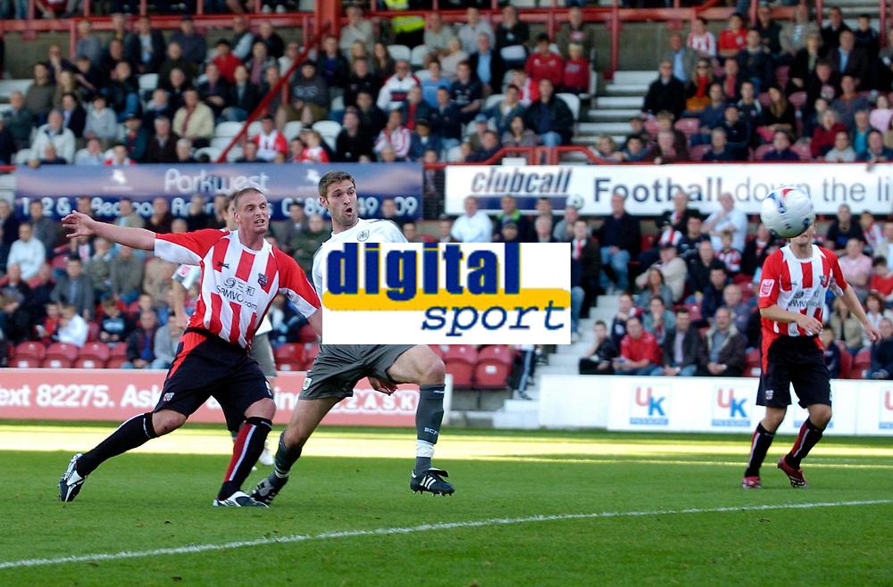 Photo: Daniel Hambury.<br />Brentford v Bristol City. Coca Cola League 1. 07/10/2006.<br />Bristol City's Jamie McCombe (R) scores to make it 0-1.
