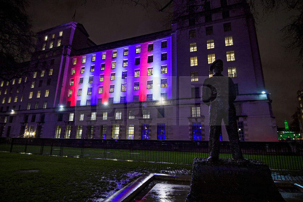 © Licensed to London News Pictures. 31/01/2020. London, UK. The MOD (Ministry of Defence) building in Whitehall lit up red, white and blue, the colours of The Union Flag in celebration of the day that the UK leaves the European Union. 51.9% of the UK population voted to leave the EU in a referendum in June 2016. Photo credit: Ben Cawthra/LNP