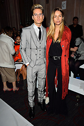 © Licensed to London News Pictures. 19/02/2016. OLIVER PROUDLOCK and EMMA LOUISE CONNOLLY attend the PAUL COSTELLO Autumn/Winter 2016 presentation. Models, buyers, celebrities and the stylish descend upon London Fashion Week for the Autumn/Winters 2016 clothes collection shows. London, UK. Photo credit: Ray Tang/LNP