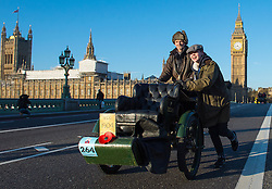 EDITORIAL USE ONLY Two participants push a 1904 Humber car over Westminster Bridge during the Bonhams London to Brighton Veteran Car Run in London.