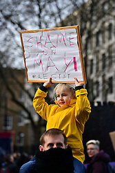 © Licensed to London News Pictures. 04/02/2017. London, UK. 5 year old Lara holds a sign while taking part in A demonstration against U.S President Donald Trump's Executive Order banning refugees and immigrants from a number of Muslim-majority countries. Protestors join campaign groups including Stop the War, Stand up to Racism, Muslim Association of Britain, in a march from the U.S Embassy in London to Downing Street. Photo credit: Ben Cawthra/LNP