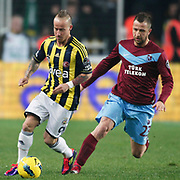 Fenerbahce's Mirosloav Stoch (L) and Trabzonspor's Remzi Giray Kacar (R) during their Turkish superleague soccer derby match Fenerbahce between Trabzonspor at the Sukru Saracaoglu stadium in Istanbul Turkey on Sunday 18 December 2011. Photo by TURKPIX
