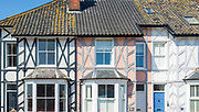 Architectural detail of historic houses in High Street, Aldeburgh, Suffolk, England, UK - Mock Tudor style