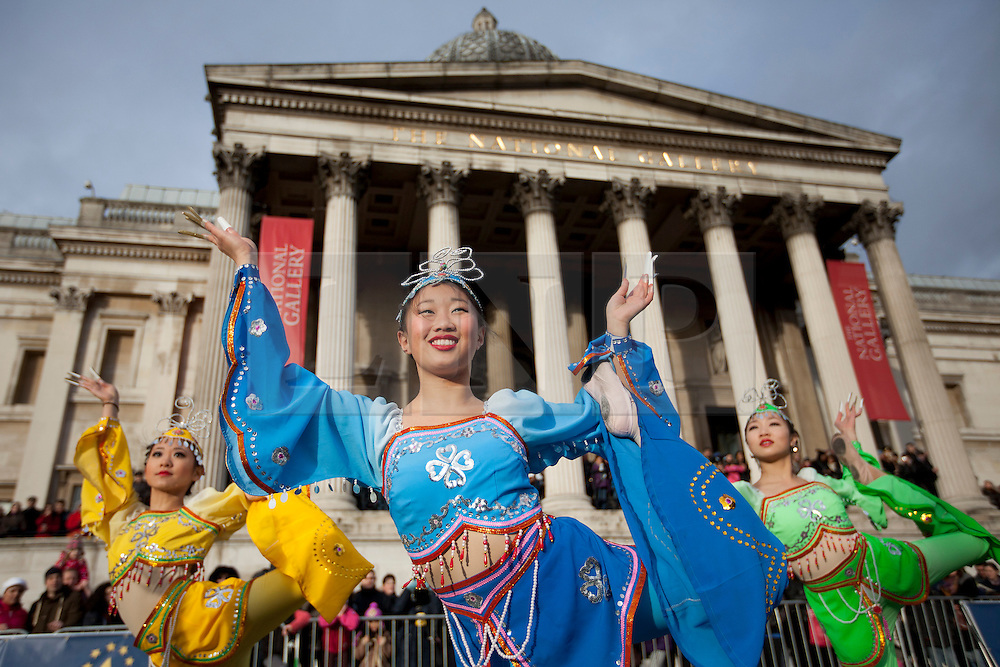 © Licensed to London News Pictures. 30/12/2012. London, UK. Dancers of American Chinese Arts Society from Newton Massachusetts USA, are seen performing in Trafalgar Square today (30/12/12) as part of a preview for London's 2012 New Years Day Parade. The parade, featuring more than 6000 performers, is set to take place on the New Year's Day, the 1st of January 2013, in the West End of London. Photo credit: Matt Cetti-Roberts/LNP