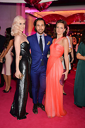 Left to right, PORTIA FREEMAN, DIEGO BIVERO-VOLPE and CHARLOTTE CARROL at The Naked Heart Foundation's Fabulous Fund Fair hosted by Natalia Vodianova and Karlie Kloss at Old Billingsgate Market, 1 Old Billingsgate Walk, London on 20th February 2016.