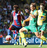 Wilfried Zaha in a close battle with Steven Whittaker during the Barclays Premier League match between Norwich City and Crystal Palace at Carrow Road, Norwich, England on 8 August 2015. Photo by Craig McAllister.