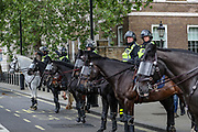 Police in riot gear and horseback patrol in central London on Wednesday, June 3, 2020, after a demonstration over the death of George Floyd, a black man who died after being restrained by Minneapolis police officers on May 25. Protests have taken place across America and internationally after a white Minneapolis police officer pressed his knee against Floyd's neck while the handcuffed black man called out that he couldn't breathe. The officer, Derek Chauvin, has been fired and charged with murder. (Photo/ Vudi Xhymshiti)