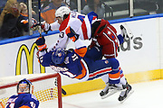 21 APR 2015:  Washington Capitals right wing Tom Wilson (43) runs through New York Islanders defenseman Lubomir Visnovsky (11) during the second period of the  Round 1 game 4 2015 Stanley Cup Playoff game between the New York Islanders and the Washington Capitals played at Nassau Veterans Memorial Coliseum in Uniondale,NY. The Washington Capitals defeat the New York Islanders 2-1 to even the series at 2-2.