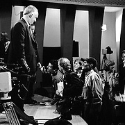 Members of the press try to get comments from commissioners as a panel breaks up during the 9/11 Commission's 11th Public Hearing, New School University, New York.