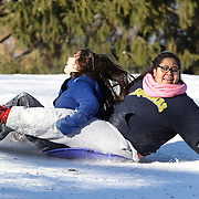 Girls sledding in Central Park after New York City was hit with over 7 inches of snow during its first winter storm of the year. Central Park, Manhattan, New York, USA. 4th January 2014 Photo Tim Clayton