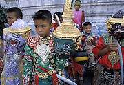 Bangkok.Boys prepare their Khon masks for a role in the Ramakien play, adapted to Siamese culture