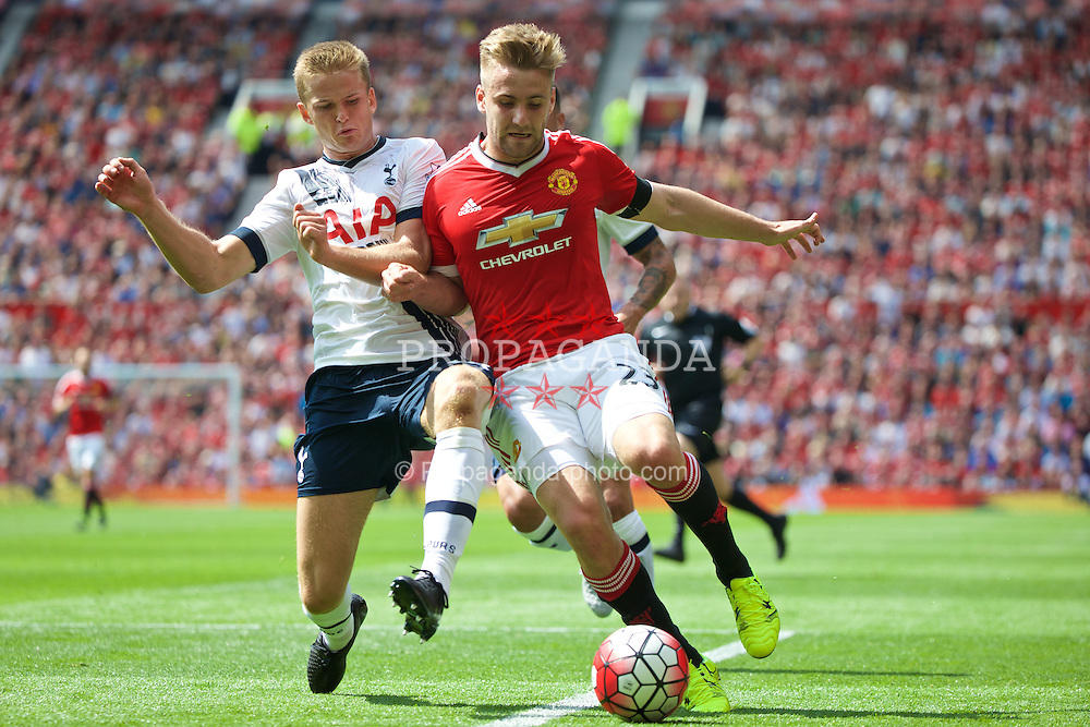 MANCHESTER, ENGLAND - Saturday, August 8, 2015: Manchester United's Luke Shaw in action against Tottenham Hotspur's Eric Dier during the Premier League match at Old Trafford. (Pic by David Rawcliffe/Propaganda)
