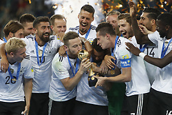 July 3, 2017 - Saint Petersburg, Russia - Shkodran Mustafi of Germany national team kisses the trophy as Germany national team players celebrate during award ceremony after FIFA Confederations Cup Russia 2017 final match between Chile and Germany at Saint Petersburg Stadium on July 2, 2017 in Saint Petersburg, Russia. (Credit Image: © Mike Kireev/NurPhoto via ZUMA Press)