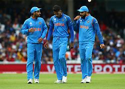 June 8, 2017 - London, United Kingdom - L-R Bhuvneshwar Kumar of India Hardik Pandya of India and Virat Kohli of India. during the ICC Champions Trophy match Group B between India and Sri Lanka at The Oval in London on June 08, 2017  (Credit Image: © Kieran Galvin/NurPhoto via ZUMA Press)