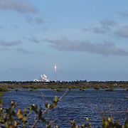 In this image taken from inside the Merritt Island National Wildlife Refuge, a SpaceX Falcon Heavy rocket is seen as it leaves Kennedy Space Center pad 39A on its inaugural test on Tuesday, February 6 2018 in Titusville, Florida. The high-power launcher also boosted Elon Musk's electric Tesla sportswear into deep space. (Alex Menendez via AP)