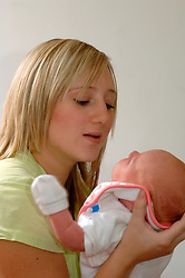 Young teenage mother with her baby girl are housed in a housing association house; Yorkshire UK