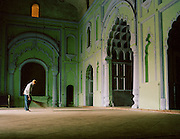 Caretaker sweeps the floor inside the Great Imambara, Lucknow, Uttar Pradesh, India
