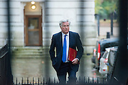 © Licensed to London News Pictures. 18/11/2014. Westminster, UK. The Rt Hon Michael Fallon MP Secretary of State for Defence arrives for the Cabinet and COBRA meetings.  Ministers and MP's on Downing Street 18th November 2014. Photo credit : Stephen Simpson/LNP