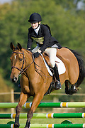 Horse and rider in the showjumping phase of an eventing competition, Charlton Park, Wiltshire, United Kingdom